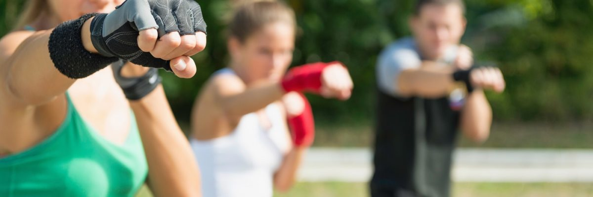 Taebo team in training, direct punch. Selective focus on fist